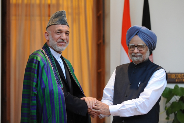 <p>President of Afghanistan Hamid Karzai (L) shakes hands with Indian Prime Minister Manmohan Singh (R) during a meeting in New Delhi on October 4, 2011.  Afghanistan and India, two nations united in their suspicion of Pakistan, are set to forge closer ties as Hamid Karzai visits New Delhi during a highly unstable time in South Asia. The Afghan president, making his second trip to the Indian capital this year, and  meet Indian Prime Minister Manmohan Singh against a backdrop of shifting relations in the war-wracked and nuclear-armed region.</p>