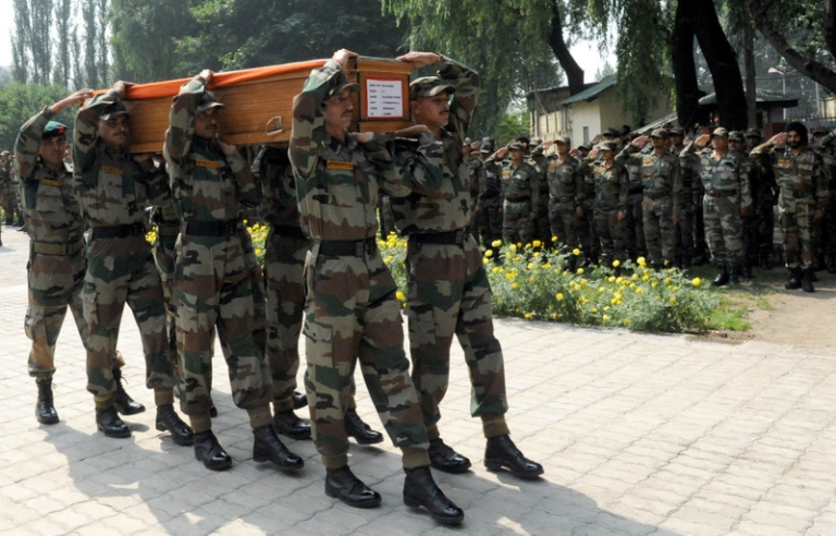 <p>Indian army soldier carry a coffin containing the body of a army officer during a wreath laying ceremony after in Srinagar on August 21, 2011. An Indian army lieutenant and a dozen suspected militants were killed on August 20 in a clash along the de facto border that splits Kashmir between India and Pakistan, the army said. The fighting erupted in the northern Gurez district when a group of