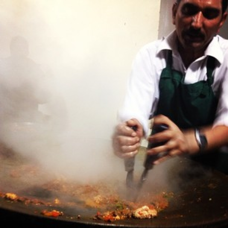 <p>This is how katakat is made at Karachi's famous Noorani Restaurant. Yes, that is brain in the corner.</p>