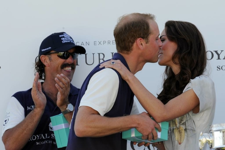 <p>Kate was so proud of her husband's team winning the polo challenge that she kissed him on stage, which is rare to see from the private newlyweds.  Meanwhile, Will's teammate and fellow champion, Santi Trotz, teased the couple by sticking out his tongue.</p>