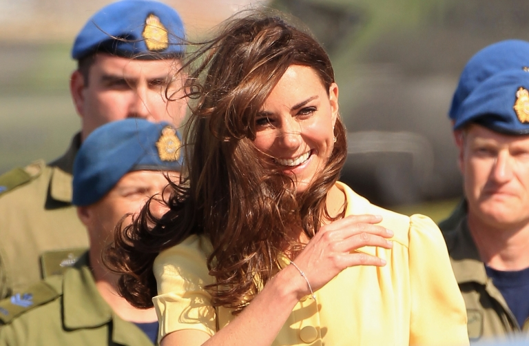 <p>Kate battles a strong wind at the Calgary Airport on July 7, 2011 in Calgary, Canada.  She and Will went to Calgary to watch a rodeo demonstration on their final stretch of their Canadian visit.</p>