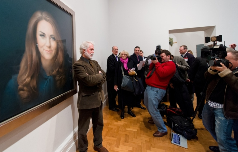 <p>Artist Paul Emsley poses in front of his portrait of Catherine, the Duchess of Cambridge, after its unveiling at the National Portrait Gallery in central London on January 11, 2013. This is the first official portrait of the Duchess and was completed after two sittings at the artist's studio and Kensington Palace.</p>