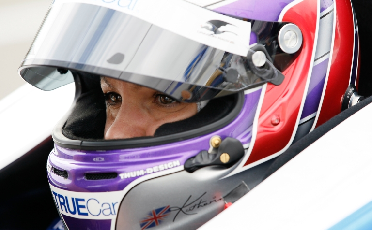 <p>BIRMINGHAM, AL - MARCH 30: Katherine Legge of England, driver of the #6 Lotus-Dragon Racing Lotus, waits in the pits during practice for the IndyCar Series Honda Indy Grand Prix of Alabama presented by Legacy at Barber Motorsports Park on March 30, 2012.</p>