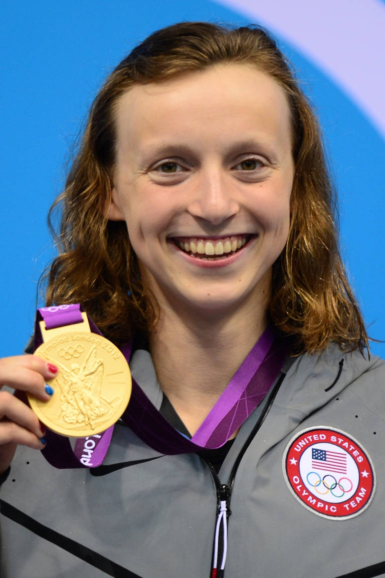 <p>US swimmer Katie Ledecky poses on the podium with her gold medal after winning the women's 800-meter freestyle final during the swimming event at the London 2012 Olympic Games on August 3, 2012.</p>