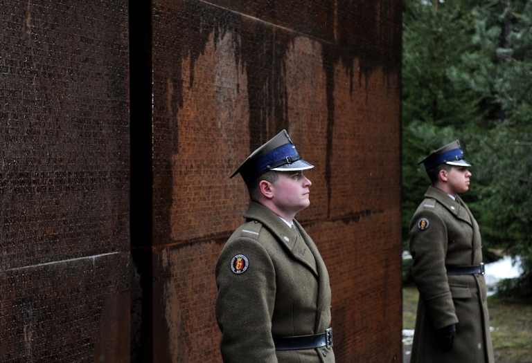 <p>Polish honour guards stand on April 9, 2011 at the monument of Polish officers murdered by Soviet secret security services in Katyn in 1940, in Katyn, on April 9, 2011.</p>