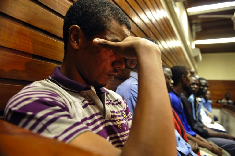 <p>29-year-old British citizen Jermaine Grant, stands inside the dock at the Momabasa Law court on January 12, 2012 court as he awaits the opening of his trial, on charges of possessing explosive materials and conspiracy to commit a felony following his arrest in December 2011 in the Kenyan coastal resort of Mombasa.</p>
