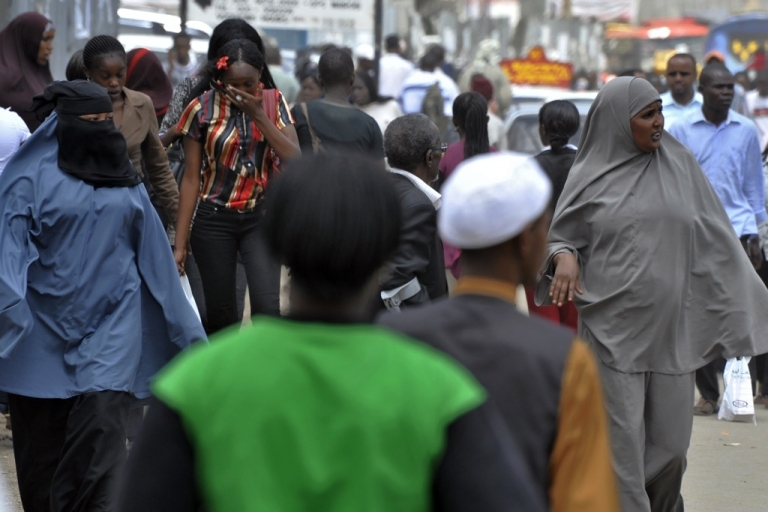 <p>Residents of Eastleigh, a Nairobi neighborhood known for its Somali immigrant population, walk on January 18, 2010 in a commercial street.</p>