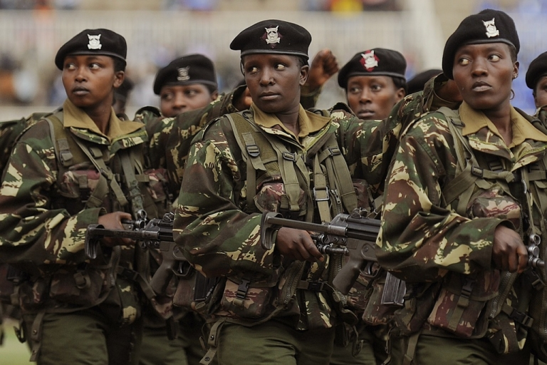 <p>Kenya is sending troops into Somalia to pursue the Islamic extremist rebels. Troops are also patrolling Kenya against retaliation terror attacks. Here women in Kenya's armed forces march during the Heroes Day celebrations in Nairobi on October 20, 2011.</p>