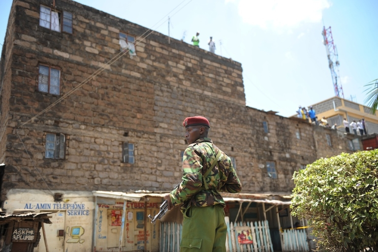 <p>A policeman stands guard next to the site where a blast ripped through a church in Nairobi on September 30, 2012.</p>