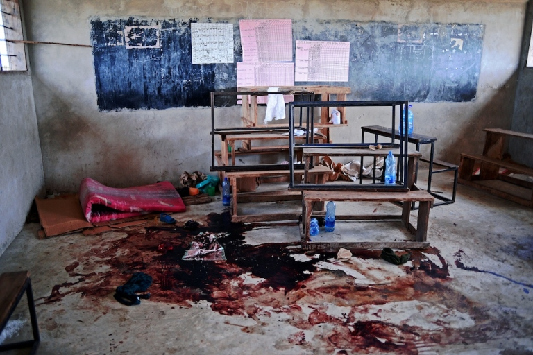 <p>Blood stains the floor of a classroom in Kilelengwani village in the Tana river Delta on September 12, 2012. Orma tribe villagers and the Red Cross claim 8 children were slaughtered in the classroom by members of the Pokomo tribe during an attack by 300 tribesmen on the village which left 38 people dead,167 houses burnt to the ground, and scores of slaughtered cattle. The Kenyan government has authorised a deployment of 1,300 General Service Unit (GSU) officers, the Kenyan specialist riot police squad, in the area and a dusk to dawn curfew, after 112 people were killed in clashes between the Pokomo and Orma tribes since late August 2012.</p>