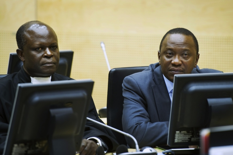 <p>Uhuru Kenyatta (R) and a member of the Defense Council (L) attend a hearing at the International Criminal Court (ICC) in The Hague on September 21, 2011. The ICC prosecutor has accused six Kenyan political and business leaders of being behind Kenya's 2007 to 2008 post-election violence in which 1,200 people were killed.</p>