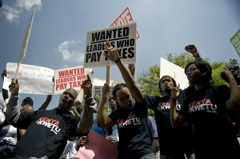 <p>Kenyan demonstrators march in Nairobi on October 9, 2012 after lawmakers voted themselves a $110,000 sendoff bonus, with tax hikes expected to pay for it. The proposed lucrative payoff -- at a cost to the country of $24.7 million -- comes after Kenya's parliament dismissed the majority of wage demands of striking public sector workers, including doctors and teachers.</p>