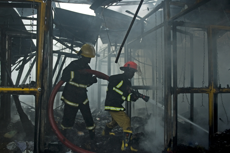 <p>Firefighters extinguish a fire at the site of a blast in central Nairobi on Moi Avenue on May 28, 2012. A large blast that wounded dozens of people in the center of the Kenyan capital was labeled as a