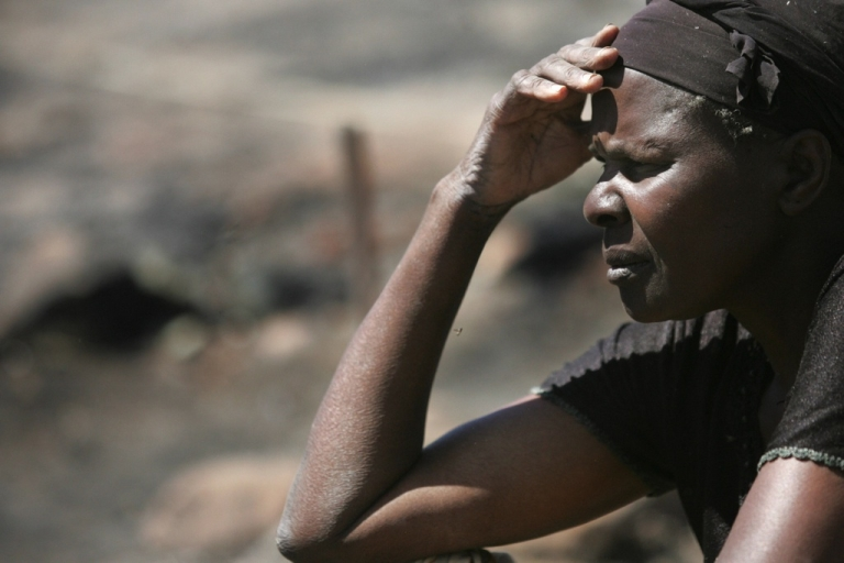 <p>A Kenyan store owner sits in Nairobi on Jan. 1, 2008, amid the burned out remains of what used to be a second-hand clothes market that was destroyed by looters during a wake of violence that engulfed the country after disputed presidential elections.</p>