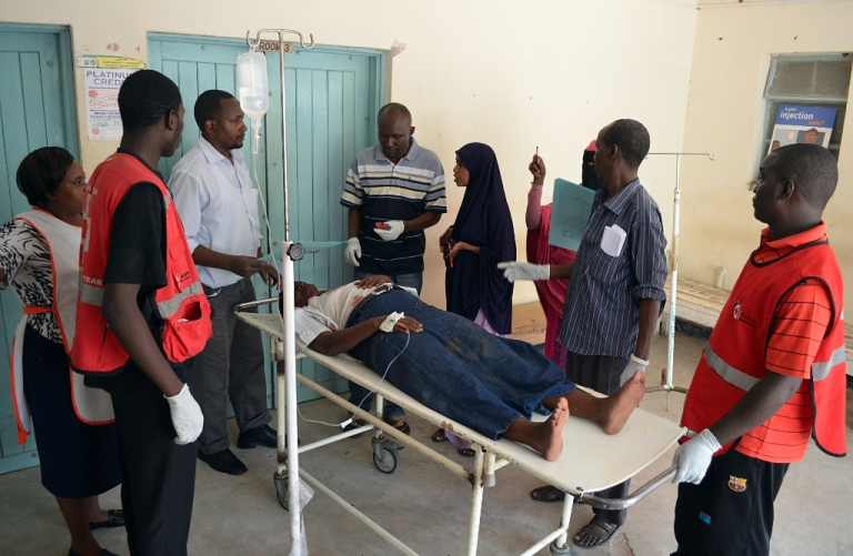 <p>A man is stretchered as he arrives at the Garissa General Provincial Hospital, close to the border with Somalia, on November 4, 2012 after a grenade attack on a Kenyan church that left one policeman dead and 14 other people wounded. Kenya has seen a wave of grenade attacks on cities including the capital Nairobi and the key port of Mombasa since the country sent troops into Somalia in October last year to fight Al-Qaeda-linked Shebab insurgents.</p>
