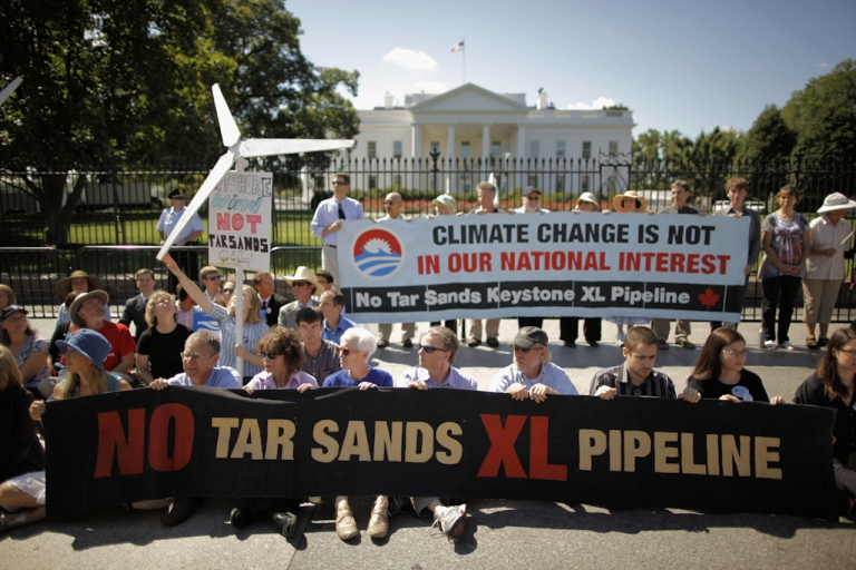 <p>Keystone XL pipeline protesters in front of the White House in Washington, DC.</p>