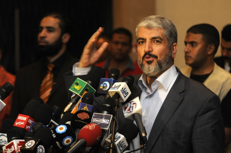 <p>Exiled Palestinian Hamas leader Khaled Meshaal addresses a meeting in Cairo with some 40 Palestinian prisoners who were freed by Israel but were to be deported overseas in October.</p>
