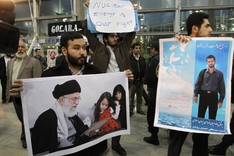 <p>Iranian students hold posters of assassinated nuclear scientist Mostafa Ahmadi-Roshan and a picture of the family of slain nuclear scientist Dariush Rezaei with Iran's Supreme Leader, Ayatollah Ali Khamenei, in Tehran on Jan. 29. Khamenei said Iran would defend both its oil production and nuclear program while offering aid to anyone attacking Israel.</p>