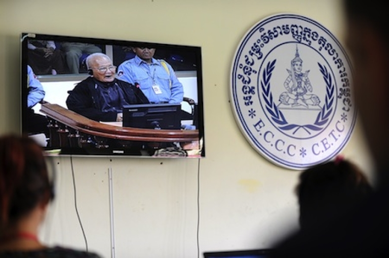 <p>Cambodian and foreign journalists listen to former Khmer Rouge leader 'Brother Number Two' Nuon Chea speaking during a live feed video at ongoing Khmer Rouge war crimes tribunals.</p>
