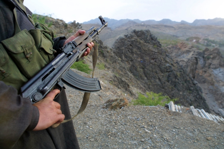 <p>A Pakistani solider stands guard overlooking the Khyber Pass on the Pakistani border with Afghanistan.</p>