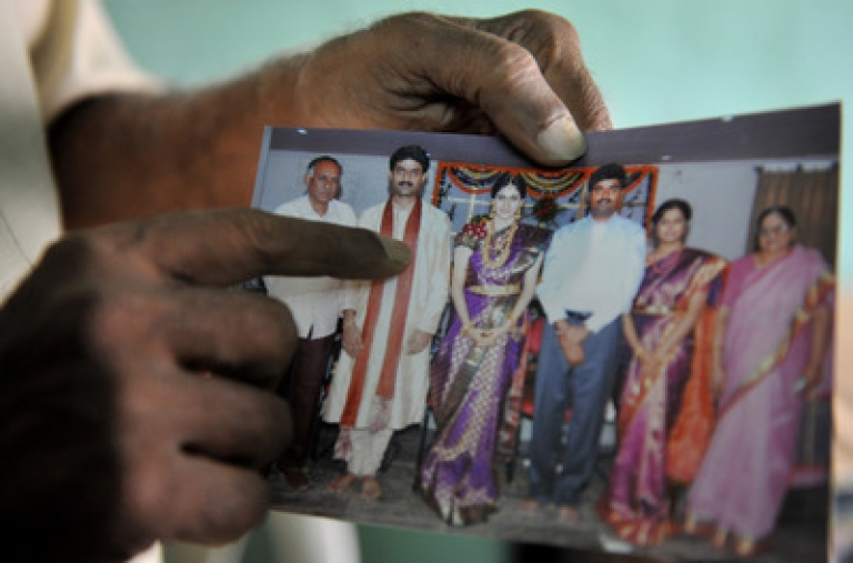<p>Relative of abducted chief administrator of India's Orrissa state  R. Vineel Krishna, Y.Mohan Rao ,shows a family photograph featuring Krishna (2-L) at the family home in Hyderabad on February 17, 2011.   Maoist rebels in the eastern Indian state of Orissa have kidnapped a senior local official and demanded an end to security force operations in the area, police said. R. Vineel Krishna, chief administrator of the insurgency-hit Malkanagiri district, and one of his aides were taken hostage on February 16, 2011 night some 620 kilometres (380 miles) south of the state capital Bhubaneswar.</p>