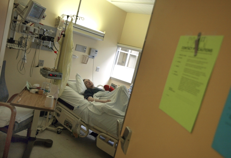 <p>A man rests in his hospital room in the medical center at the University of Chicago on June 6, 2003, after kidney, liver and heart transplants.</p>