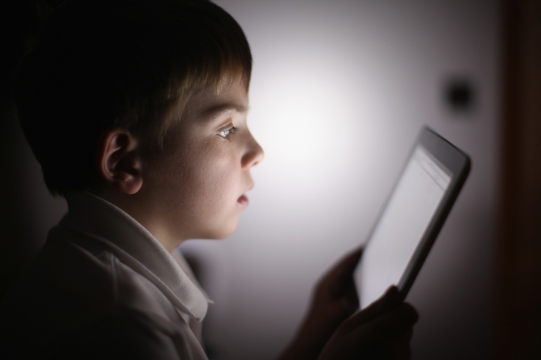 <p>A ten-year-old boy uses an Apple iPad tablet computer on November 29, 2011 in the UK. Facebook is testing out technologies that would allow children 13 and under to use the site.</p>