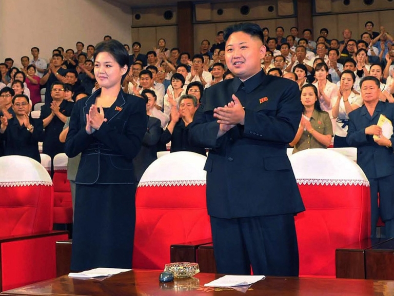 <p>North Korean leader Kim Jong Un (center) enjoys a performance in Pyongyang with a young woman (left), likely his wife Ri Sol Ju. The photo was taken on July 6, 2012, by North Korean official Korean Central News Agency.</p>