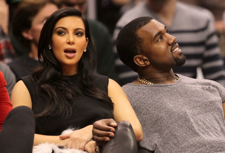 <p>Kim Kardashian and Kanye West attend the NBA game between the Denver Nuggets and the Los Angeles Clippers at Staples Center on Dec. 25, 2012 in Los Angeles, California.</p>