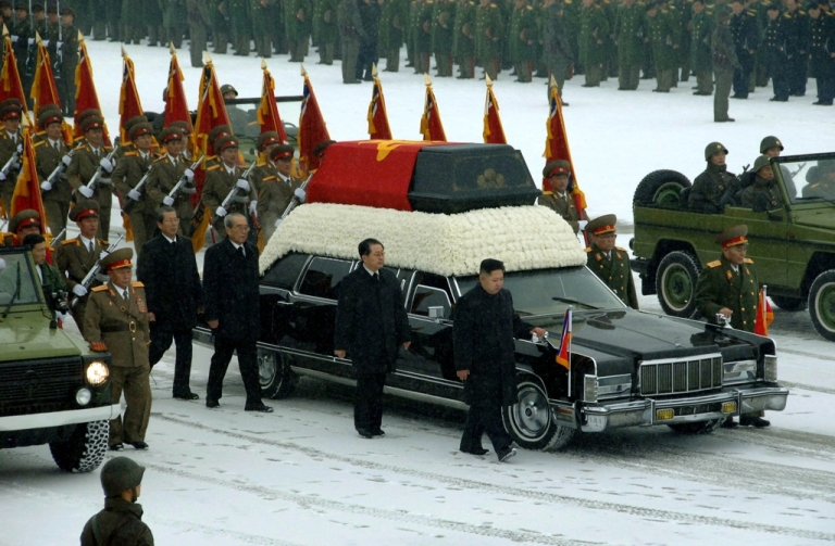 <p>This handout picture taken by North Korea's official Korean Central News Agency (KCNA) on December 28, 2011, shows Kim Jong Un (center R) and Jang Song-Thaek (C) besides the convoy carrying the body of Kim's father and late leader Kim Jong Il at Kumsusan Memorial Palace in Pyongyang.</p>