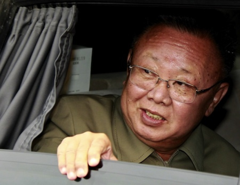 <p>North Korea's leader Kim Jong-Il peers out of a car window after a meeting with Russian officials on August 24, 2011.</p>