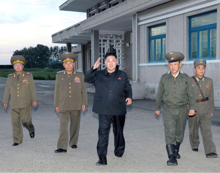 <p>This undated photo released by North Korea's official Korean Central News Agency (KCNA) on August 8, 2012 shows North Korean leader Kim Jong-Un (C) saluting to pilots during a flight training at Unit 1017 of the Air and Anti-Air Forces of the Korean People's Army.</p>