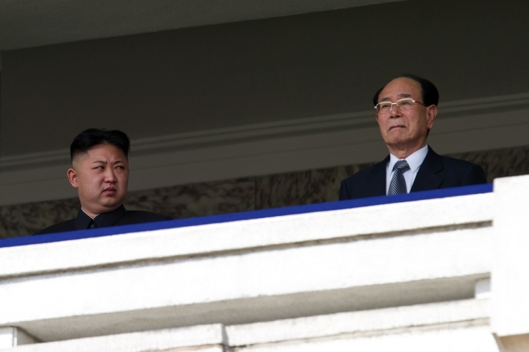 <p>North Korean leader Kim Jong-Un (L) looks at President of the Presidium of the Supreme People's Assembly of North Korea Kim Yong-nam (R) during a military parade. There are unconfirmed rumors about Kim Jong Un's plans for his government.</p>