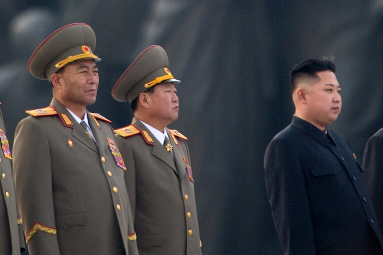 <p>This photo taken on April 13, 2012 shows North Korean military chief Ri Yong-Ho (L) and North Korean leader Kin Jong-Un (R) at a ceremony in Pyongyang. North Korea's army chief Ri Yong-Ho has been relieved of all his posts due to illness, state media said on July 16, 2012, in a surprise development that removes one of new leader Kim Jong-Un's inner circle.</p>