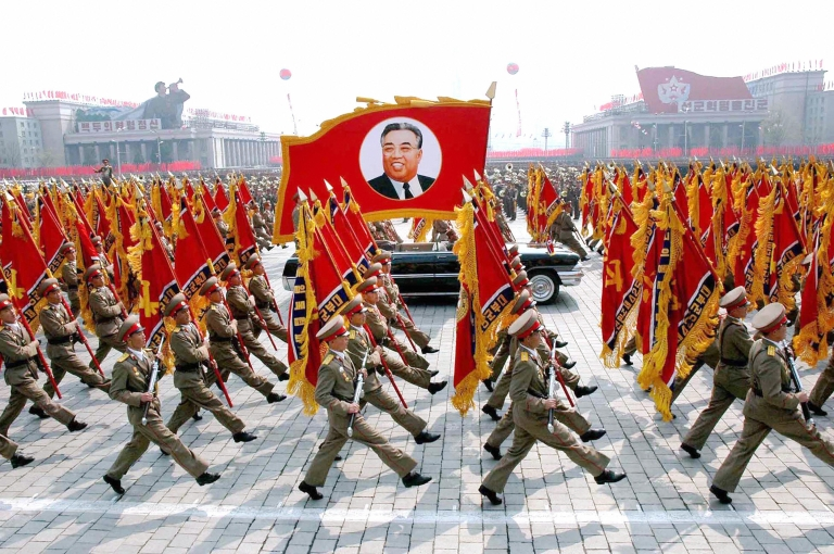 <p>his 25 April 2007 picture, released from Korean Central News Agency 26 April, shows North Korean soldiers, carrying a large portrait of late North Korean leader Kim Il Sung, marching during a grand military parade to celebrate the 75th founding anniversary of the KPA at the Kim Il Sung square in Pyongyang.</p>