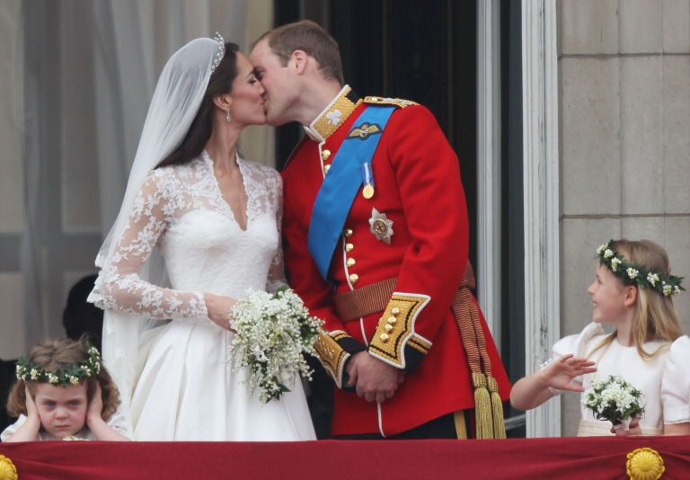 <p>William and Kate, the presumptive future monarchs of the United Kingdom, kiss in front of thousands of cheering fans who flocked to Buckingham Palace in April 2011 to wish the newlywed couple well. Not everyone in attendance was jubilant, however; it seems that 3-year old bridesmaid, Grace Van Cutsem, was a little grumpy that day.</p>