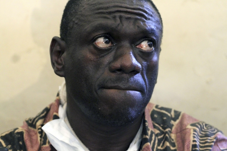 <p>Photo taken on April 18, 2011 shows opposition leader Kizza Besigye awaiting with a broken-arm the judgement of the local court in Kasangati after he was arrested in the morning to be charged for his activities a week earlier, when he tried to lead a protest march.</p>