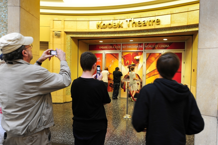 <p>Tourists take snapshots outside the Kodak Theatre on May 1, 2012 in Hollywood, California, the venue that hosts the annual Oscars show which was renamed the Dolby Theatre on May 1, 2012, after the audio pioneer gained naming rights previously held by the bankrupt camera company Kodak.</p>