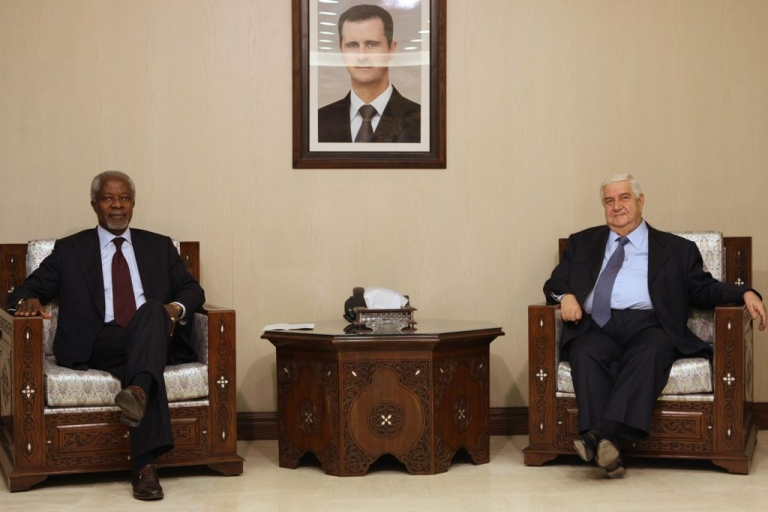 <p>UN-Arab League peace envoy Kofi Annan meets with Syrian Foreign Minister Walid Muallem under a portrait of President Bashar al-Assad in Damascus on May 28, 2012.</p>