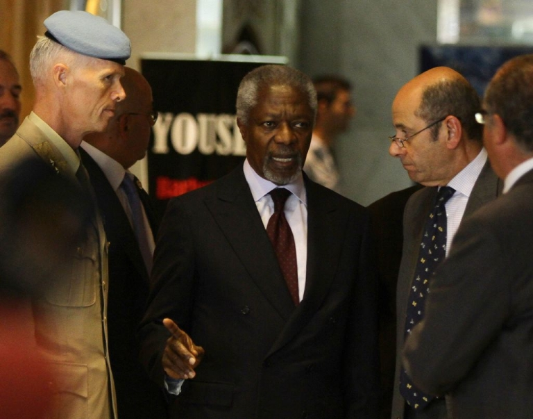 <p>UN-Arab League peace envoy Kofi Annan (C) speaks with UN mission chief in Syria Major General Robert Mood (L) as Annan's spokesman Ahmad Fawzi (2nd R) listens on upon the envoy's arrival in Damascus for talks with top officials on May 28, 2012.</p>