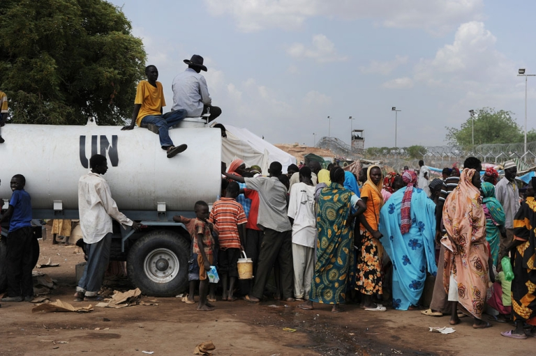 <p>Some of the 60,000 people who have been forced to flee their homes in South Kordofan gather outside a UN base close to the main town of Kadugli.</p>