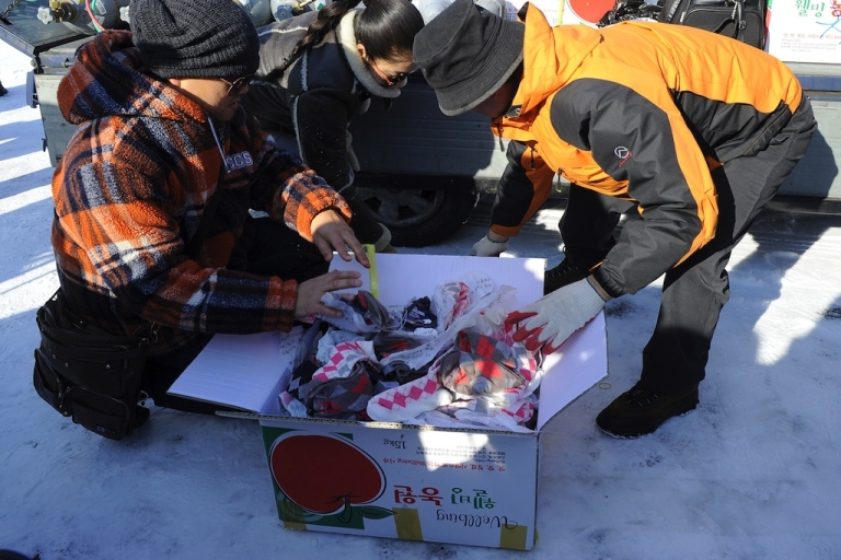 <p>Using gas-filled ballones, socks and a leaflet reading, 'We, from all countries, love you' were sent from South Korea to a place in North Korea where people can exchange socks for food on Dec. 24, 2011.</p>