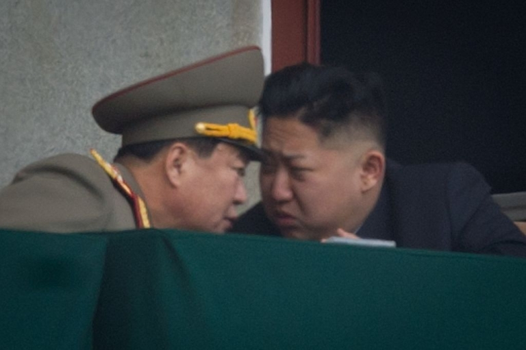 <p>North Korea's leader Kim Jong-Un (R) talks to a military aide during an official ceremony at the Kim Il-Sung stadium in Pyongyang on Apr. 14, 2012. North Korea will mark the 100th birthday of its founder Kim Il-Sung on Apr. 15.</p>