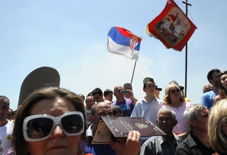 <p>Serbia's residents attend a rally marking a historic battle at Gazimestan, near Pristina on June 28, 2012.</p>