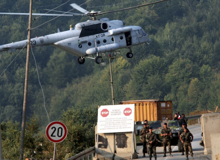<p>French KFOR soldiers guard the border crossing between Serbia and northern Kosovo at Brnjak on September 16, 2011. Kosovo and EU police were deployed at two disputed border crossings with Serbia in a move that raised fears of a fresh wave of ethnic violence in a tense Balkan region.</p>