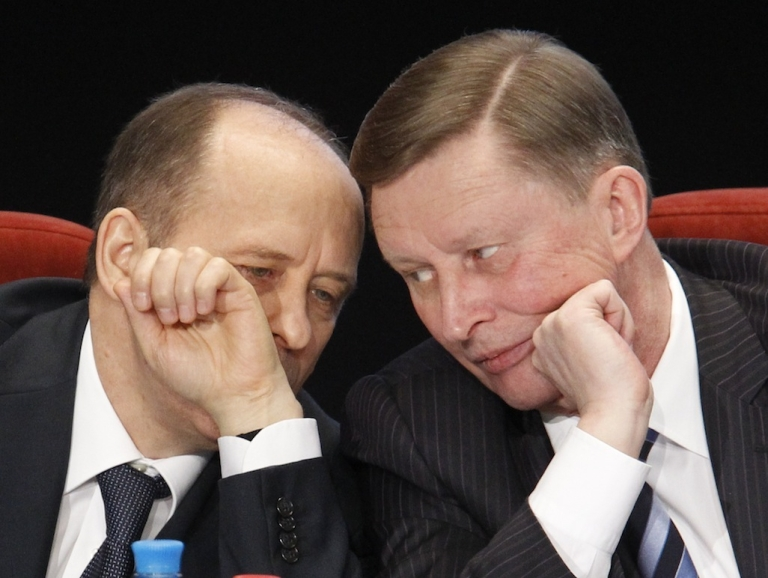 <p>Kremlin Chief of Staff Sergei Ivanov (R) listens to Director of the Federal Security Service (FSB) Alexander Bortnikov during a meeting, held by the Russian Interior Ministry board, in Moscow, on Feb. 10, 2012.</p>