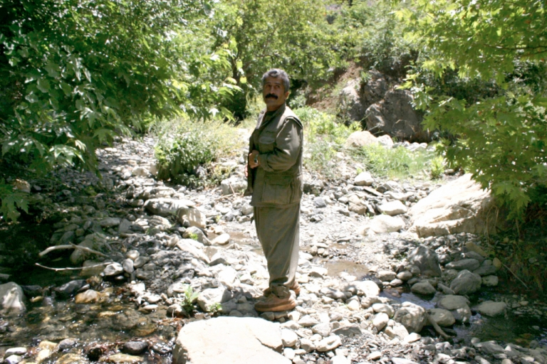 <p>Aso Honer, leader of the Party of Free Life of Kurdistan, stands by a mountain stream in the northern region of Qandil in Kurdistan on June 14, 2008.</p>