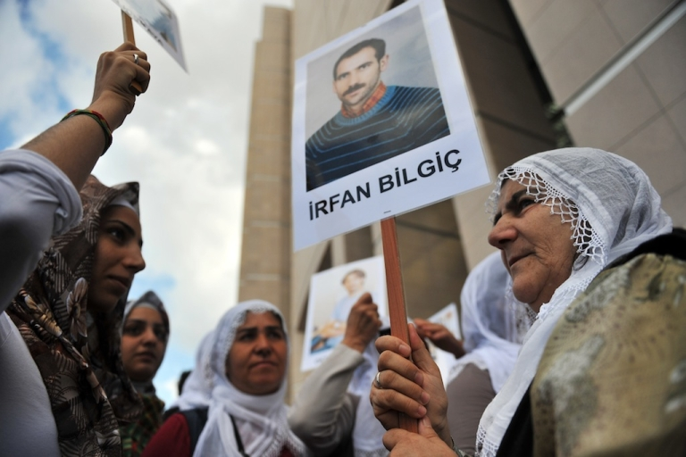 <p>Kurdish women hold pictures of jailed journalists in Istanbul on September 10, 2012, during the start of the trial of 44 journalists with suspected links to rebels from the Kurdistan Workers' Party (PKK). The Turkish government has been accused by rights groups of an on-going crackdown on Kurdish media and freedom of expression.</p>