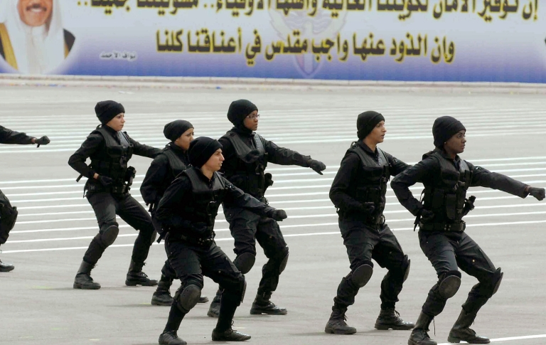 <p>Kuwaiti policewomen perform during an officers graduation ceremony at the Saad Al-Abdullah Academy for Security Sciences in Kuwait City on March 29, 2011.</p>