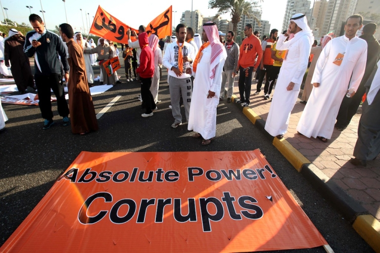 <p>Kuwaiti opposition supporters block a major road in Kuwait City on November 30, 2012, during a demonstration against a decision by Emir Sheikh Sabah al-Ahmad al-Sabah to amend the electoral law. The regime has been harsher on activists lately, and has begun jailing outspoken Twitter users and internet activists.</p>